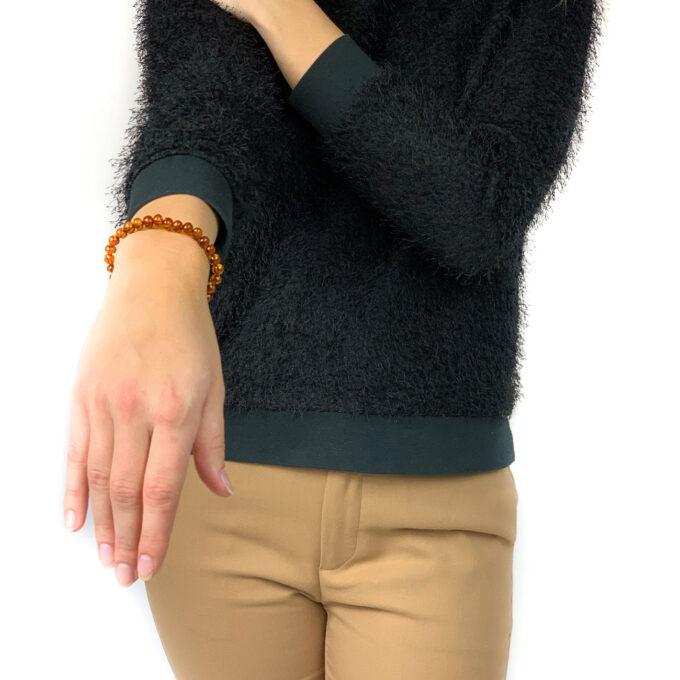 woman wearing cognac amber bracelet
