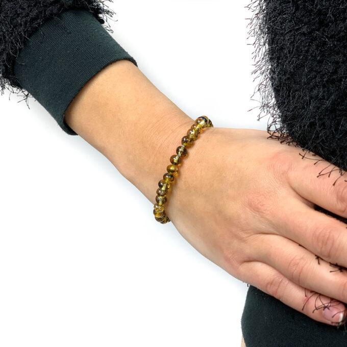 green amber bracelet on arm