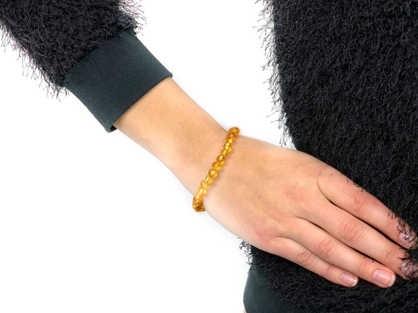 lemon color baltic amber bracelet on arm