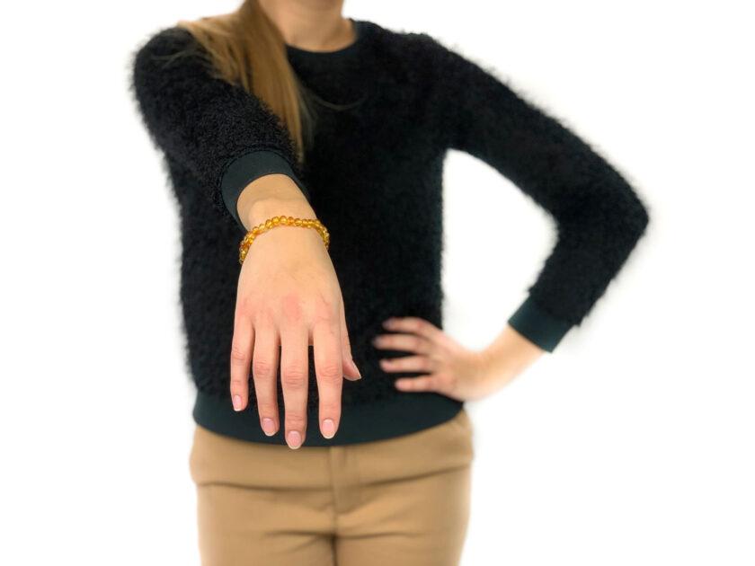 woman wearing lemon color amber bracelet
