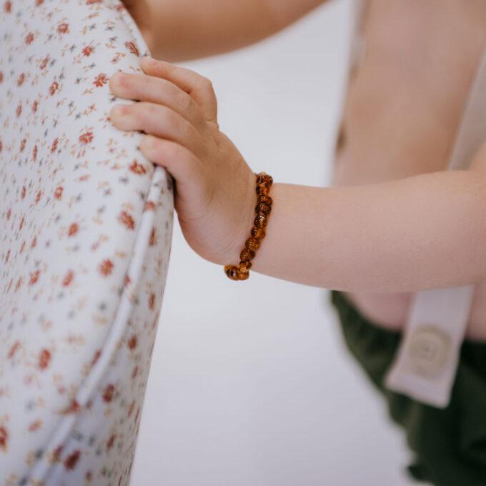 baby wearing cognac color amber teething bracelet