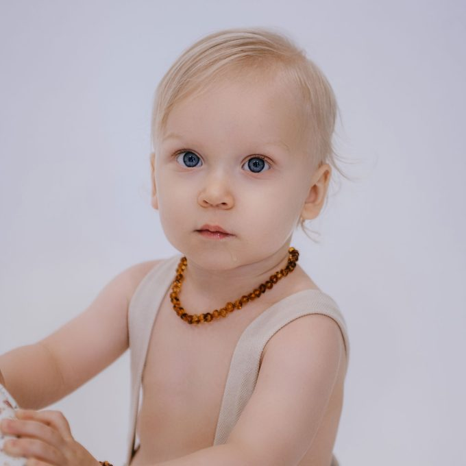 classic amber teething necklace on baby