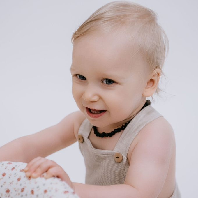 baby with raw black amber necklace for teething