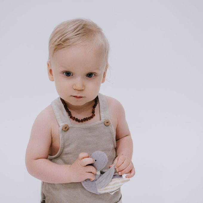 baby wearing raw cognac colour amber teething necklace