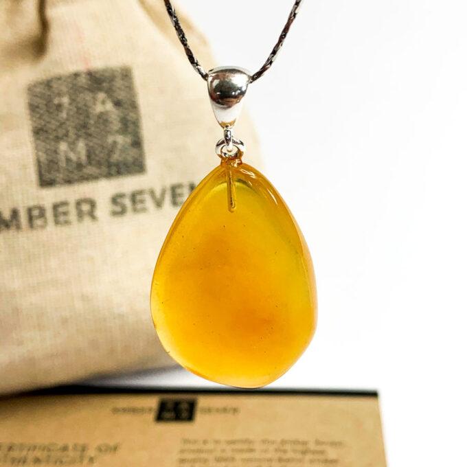 egg yolk color amber teardrop pendant with silver